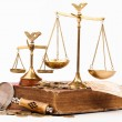 Law book, magnifying glass and scales of justice — Stock Photo