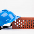 Stock Photo: Hardhat and brick
