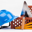 Blue hardhat, bricks and mason tools — Stock Photo