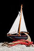 Sailing ship model and anchor — Stock Photo