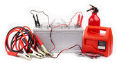 Car battery and jumper cables — Stock Photo