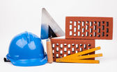Blue hardhat, bricks and mason tools — ストック写真