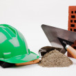 Hardhat, brick and mason tools — Stock Photo #30300213