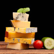 Various types of cheese isolated on black — Stock Photo