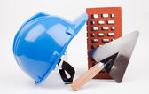 Hardhat, brick and mason trowel — Foto Stock