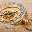 Compass in sand — Stockfoto