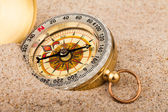 Compass on the beach — Stock Photo