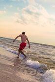 Happy man running — Stock Photo