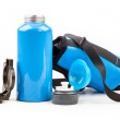 Blue metal thermos and compass — Stock Photo