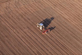 Aerial view of harvest fields with tractor — Stock Photo