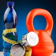 Stock Photo: Fitness dumbbells and bottle of water