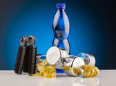 Fitness dumbbells and bottle of water — Stock Photo