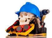 Human skull and builder tools — Stock Photo
