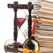 Pile of newspapers magnifying glass and hourglass — Stock Photo #38309801