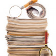 Pile of newspapers and magnifying glass — Stock Photo #38309853