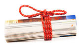 Role of newspapers with red rope — Stock Photo