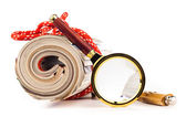 Role of newspapers and magnifying glass — Stock Photo