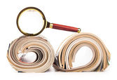 Roles of newspapers and magnifying glass — Stock Photo