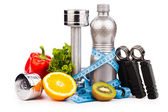 Fitness equipment with fruits and bottle of energy drink isola — Stockfoto