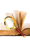 Old book and magnifying glass isolated on white — Stockfoto