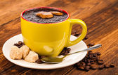 Coffee cup on old wooden table — Stock Photo