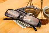 Scales of justice glasses and money — Stock Photo