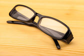 Reading glasses on table — Stock Photo