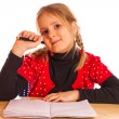 Cute little girl is writing — Stock Photo #39936677