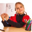 Stock Photo: Cute little girl is writing