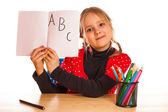 Cute little girl is writing — Stock Photo