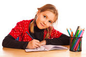 Cute little girl is writing — Foto Stock