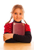 Girl is holding a book — Stock Photo