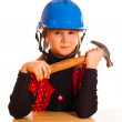 Girl and the construction helmet — Stock Photo #39959739