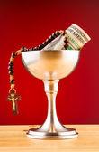 Holy communion and money — Stock Photo