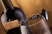 Corkscrew and wine bottle — Stock Photo