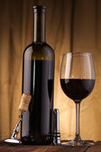 Corkscrew glass and wine bottle — Stock Photo