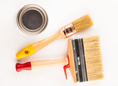 Can of paint with paintbrushes  — Stok fotoğraf