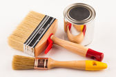 Can of paint with paintbrushes  — Stock Photo