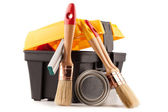 Can of paint with paintbrushes and toolbox isolated on white — Stock Photo