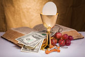 Holy communion and dollar bill — Stock Photo