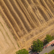 Aerial view of village road,tractor and harvest fields — Stock Photo