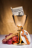 Holy communion and dollar money — Stock Photo