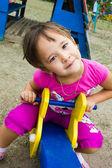 Feliz, menina a brincar no parque infantil — Foto Stock