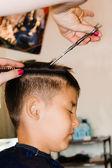 Haircut in a hair studio — Stock Photo