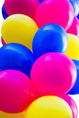 Bunch of colorful festive balloons — Stock Photo