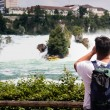 Tourists take pictures of the Rhine Falls in Switzerland — Stock Photo