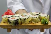 Chef holding hot rolls — Stock Photo