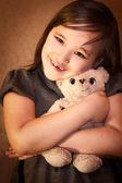 Girl carefully holding a teddy bear — Stock Photo