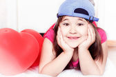 Little girl in cap smiling — Stock Photo