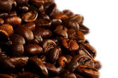 Background with many roasted coffee beans — Stock Photo